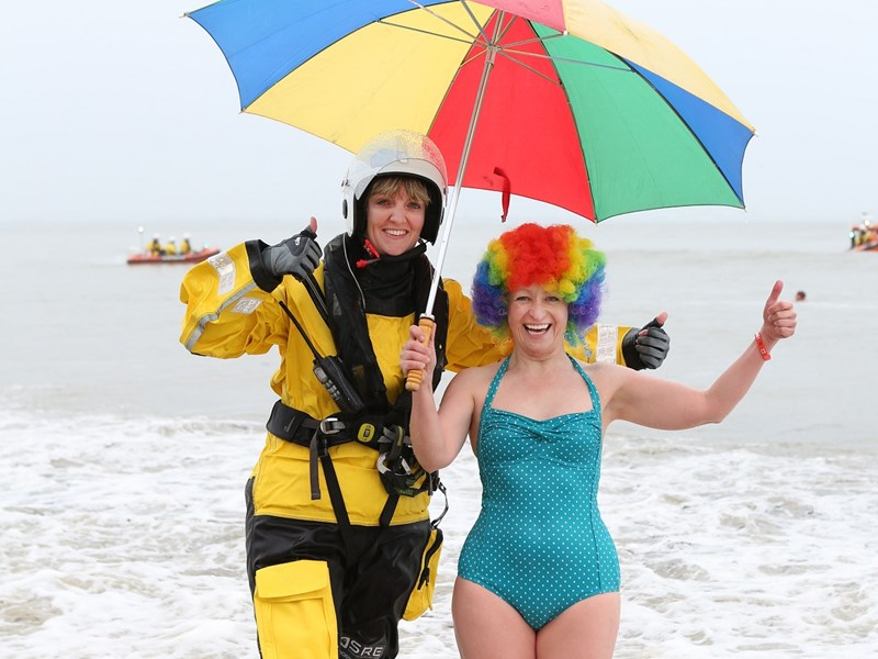 Gemma MacKinnon and Barbara Knowles at the Ryde Inshore Rescue New Year's Day swim at Appley beach. Picture by Graham Reading Photography www.grahamreading.com.