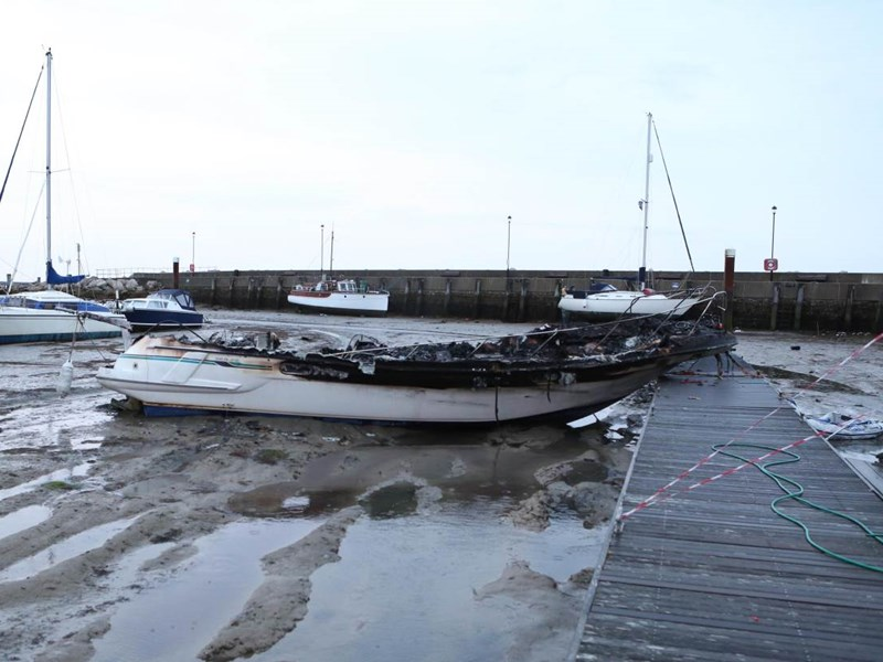 The burned out boat in Ryde Harbour. Picture by Graham Reading.