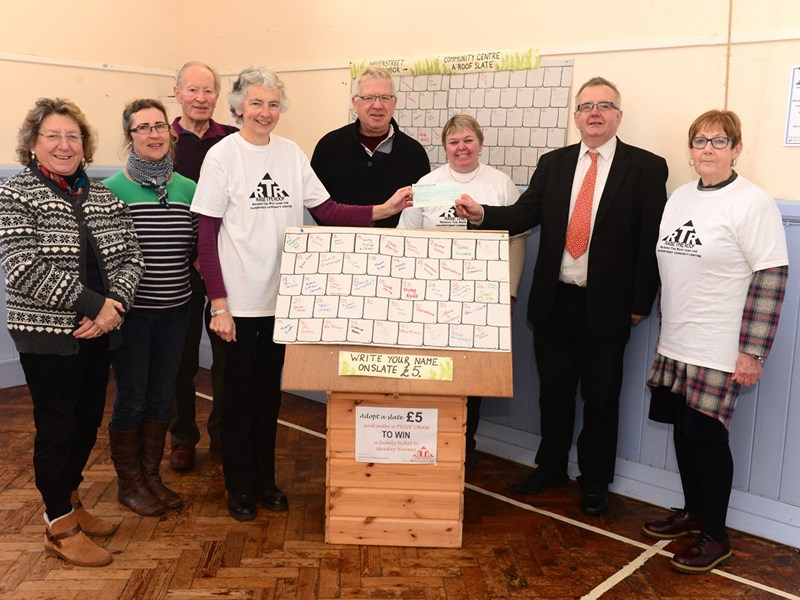 Havenstreet Community Association, from left, Veronica Hattersley, Julie Schofield, Colin Attrill, chair Lynne Broom, Paul Clarke, Sally Winter, CP publisher and editor Alan Marriott, presenting the cheque for £5,000, and Catherine Williams.