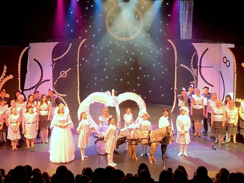 The cast of Cinderella, with Hercules. Pictures by ALLAN GREGORY