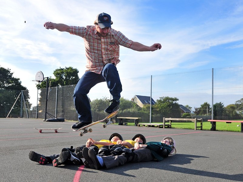 Skateboard supremo John Cattle, in the running for an Energise Me coaching award this evening, demonstrating his skills with schoolchildren at Gurnard Primary.