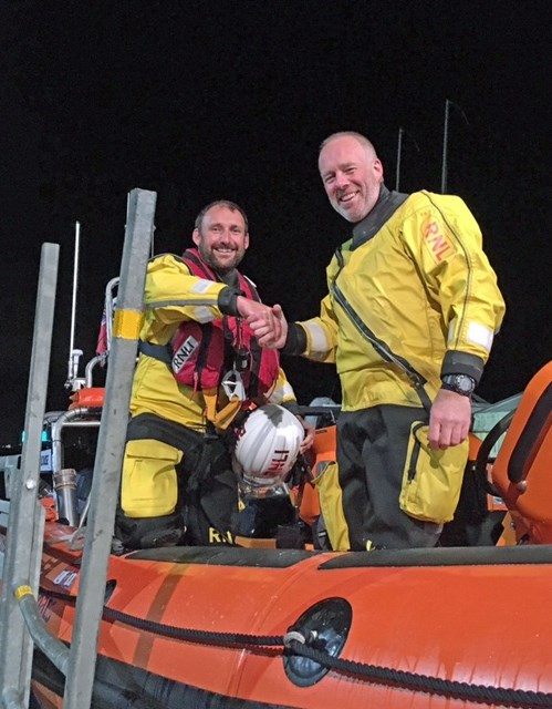 Jason (right) with Tom on the lifeboat in the station, after his successful Solent assessment.