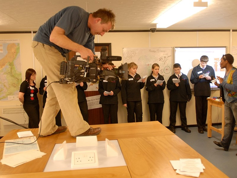Ten years ago: The BBC visited Sandown High School to film a workshop, led by a rapping geologist, for a new documentary, Fossil Detectives. The workshop was designed to teach students about geoscience in an entertaining way, using rap music, songs and poetry to get the 'geothrillogy' message across. Camerman Toby Strong is pictured filming the pupils with geologist Toyin Solanke, right.