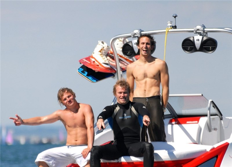 Head First, wake Boarding. (left) Josh Howell, Charlie Head and Doug Newell behind on their boat.
