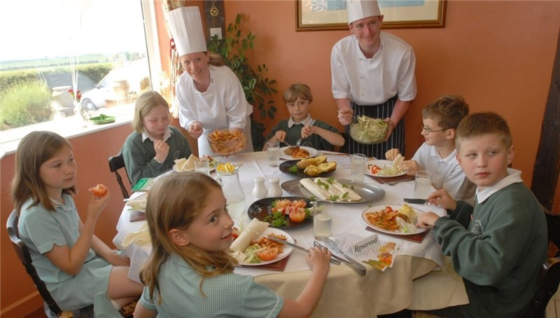 Shalfleet Primary School children having a healthy lunch at the Countryman pub, Brighstone. Clockwise from front, Freya Thorpe, Amelia Collins, Charlotte Willcock, trainee chef and former pupil Jenny Hayles, Harry Peverley, head chef Shaun Galvin, Conrad Lewindowski and George Woodburn.