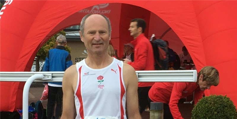 Andrew McEwen in his England vest at the Chester Marathon.