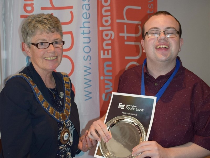 Swim England South East Awards regional president Jane Davies presenting award to Matthew Davis