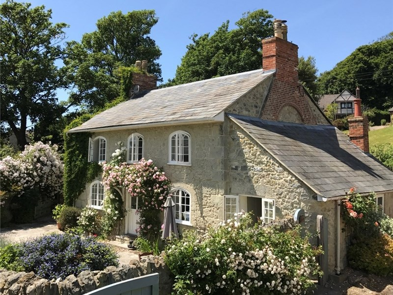 Picture perfect: Rock Cottage, in Niton, presents as the ideal fairtytale cottage. Built in the early 19th century, it exudes the charm of yesteryear.