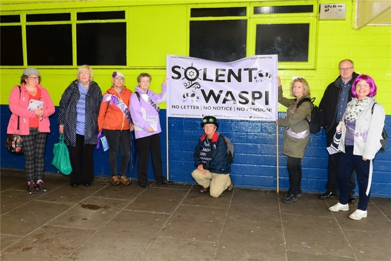 At the Solent WASPI day of action at Ryde Pier are, from left, Bridget Tuck, June Wilson, Bev Cattermole, Fiona Brown, Chris Byrne, Shelagh Simmons, Carolyne Jacobs and Julian Critchley.
