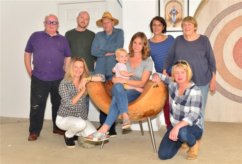Back, from left, David Firmstone, Matthew Chambers, Phil Capon, Jane Cox, Molly Atrill. Front, Amanda Wheeler, Amy Beushaw, with Abel, nine months, and Celia Wilkinson.