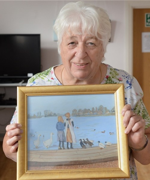 Sue with her artwork.