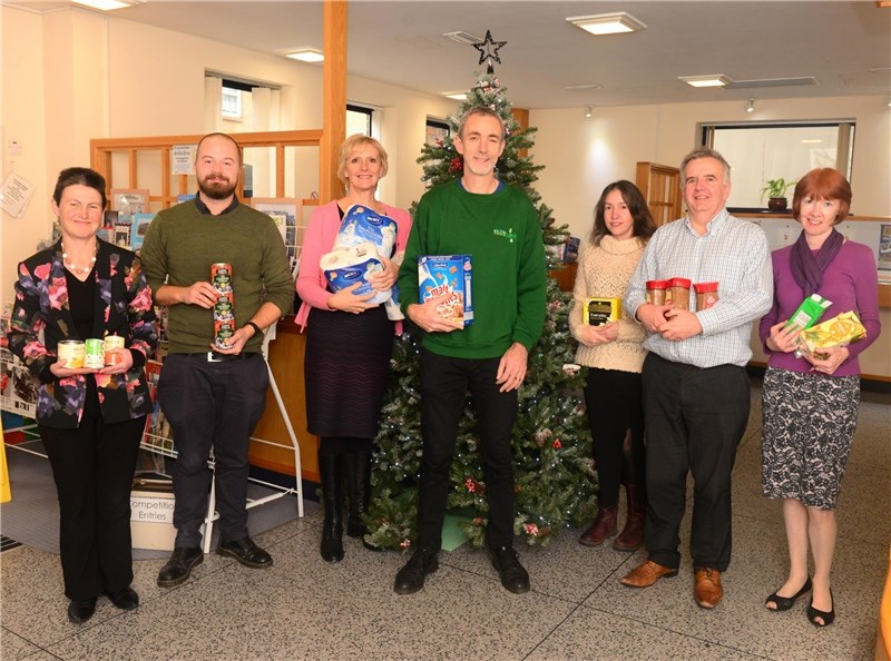 County Press staff handing over donations to the Isle of Wight 