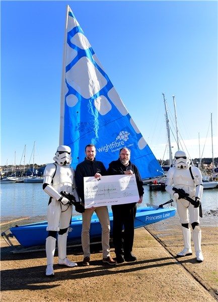 From left, stormtrooper Ross Walmsley with UKSA chief executive Ben Willows, WightFibre cheif executive John Irvine and stormtrooper Jay Bilsby.