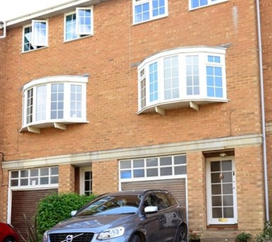 This Cowes town house on Queen's Road enjoys wide-ranging views of The Solent and accommodation over three floors.