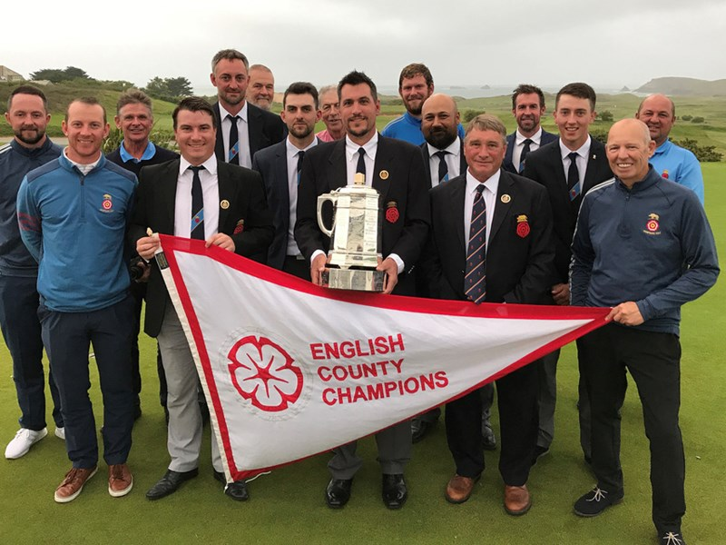 Hampshire captain Martin Young with the English County Championship trophy, with Ryan Harmer pictured behind, to his right. Picture by Andrew Griffin.