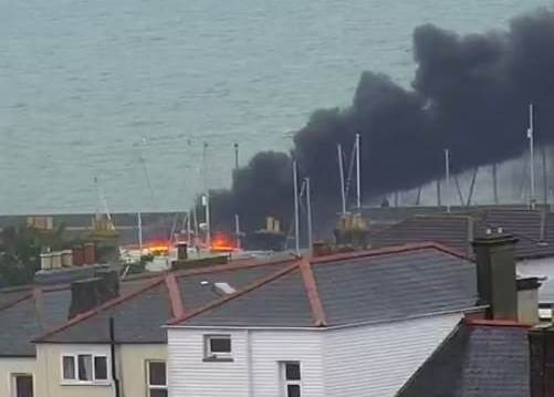 Smoke could be seen billowing from the burning boat. Picture via Isle of Wight Webcams.