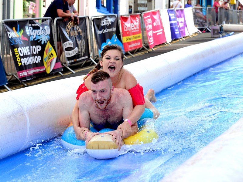 Jordan Canning with Shakira Rickman enjoying the Ryde Slide. Photo by Robin Crossley.