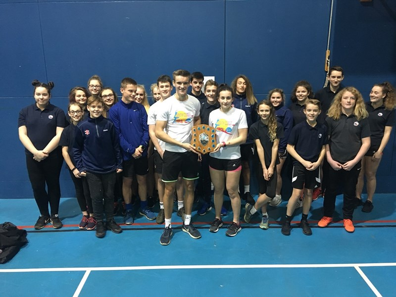 Sandown Bay Academy's winning indoor rowing team with their trophy.