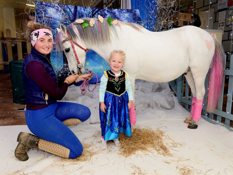 A unicorn visits Bebeccino. Amy Hose, from the Island Riding Centre, with Isla Pullinger, three, and unicorn Jasper Loveheart Sparkle.